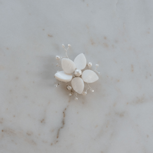 This delicate hair accessory is handmade by Vancouver Jewellery designer, Jenna of West Coast Jewelry, and makes a beautiful addition to any hairstyle. Small white faux pearls are placed on the end of silver wire stems to create little leaf-like designs, along with larger faux ivory petals.